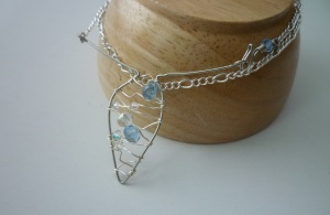 Jewelry. Amphora necklace with blue and clear crystals