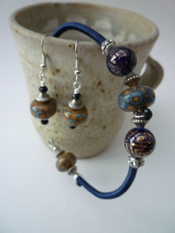 Jewelry. Bangle Earring set with Lampwork Beads silver and black crystal accents and blue coil