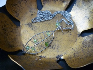 Jewelry. Leaf necklace with green crystals CLOSE UP