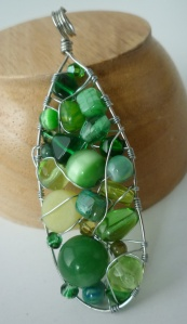 Jewelry. Wire wrapped pendant with green beads